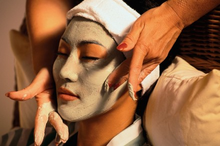 Asian Woman Receiving a Mud Mask